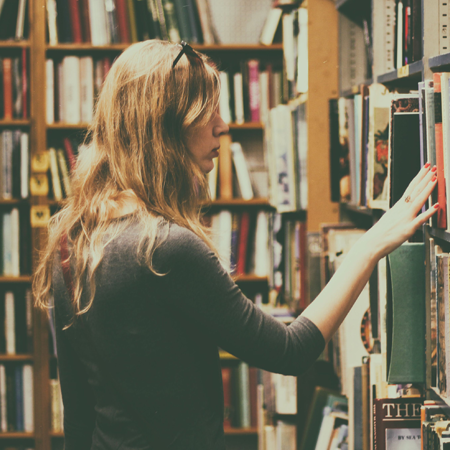 A woman browsing in a bookstore