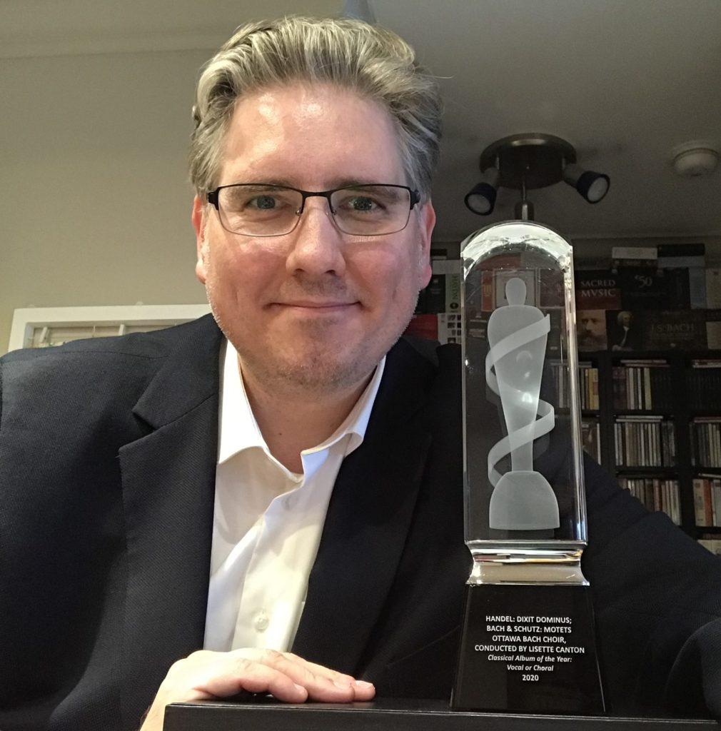 York alumnus, John Holland (PhD '18) poses with his JUNO award.