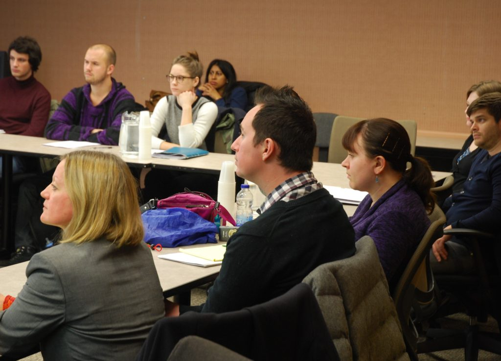 Participants on a seminar intently listening