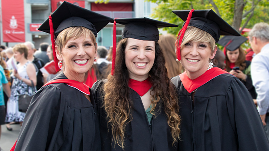 cheerful graduate with family