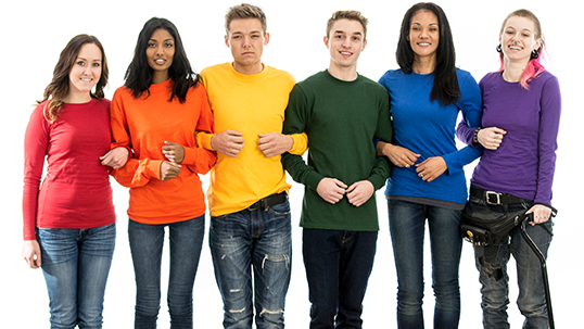 students in rainbow coloured shirts holding arms