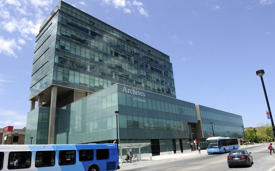 A large glass building in front of a blue sky