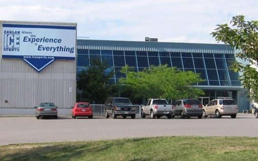 """Low-rise concrete and glass building with sign reading """"Canlan Ice Sports: Where the Experience is Everything"""""""
