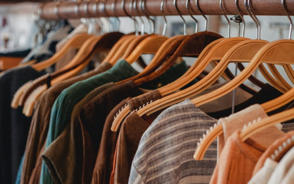 Hangers with clothes on rack