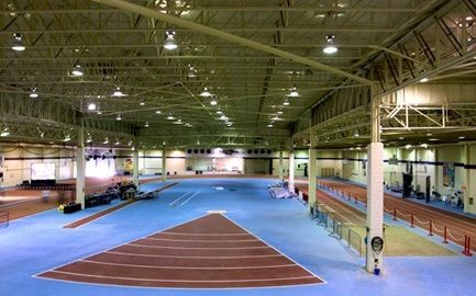 Indoor track and field facility showing running track