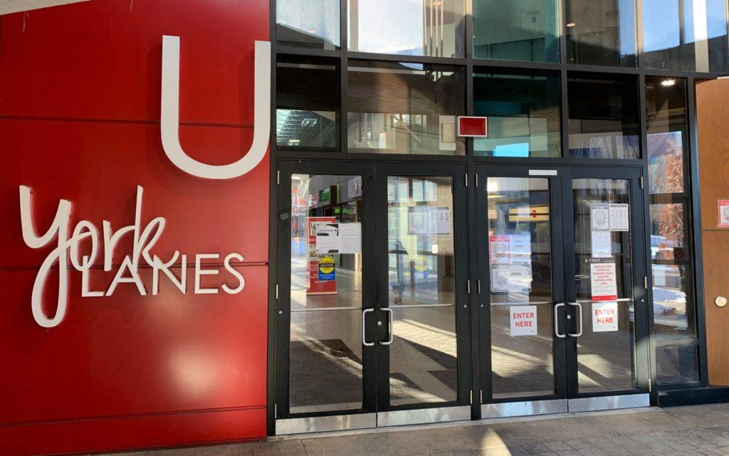 "Glass doored entrance beside sign reading ""York Lanes"""
