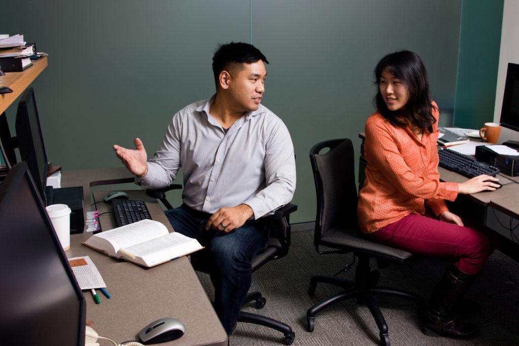 Osgoode students having a conversation at their desks