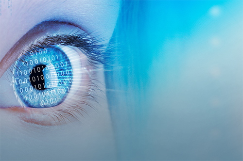 Binary numbers appear on a person's eye