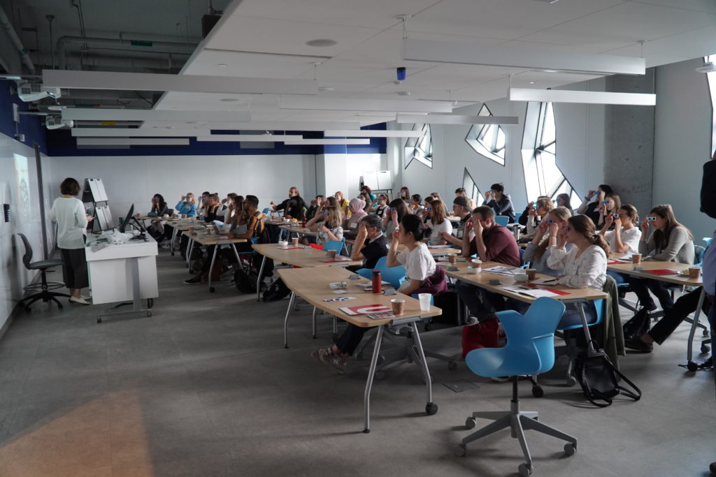 Participants of the CVR summer school are seated in a classroom, trying out anaglyph 3D glasses.
