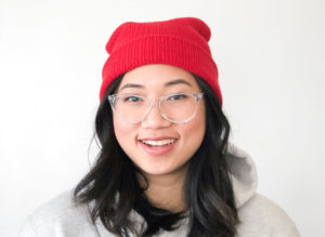 A cropped headshot of Eileen Santiago in front of a blank white wall