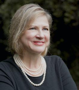 headshot of Professor Sandra Schecter smiling