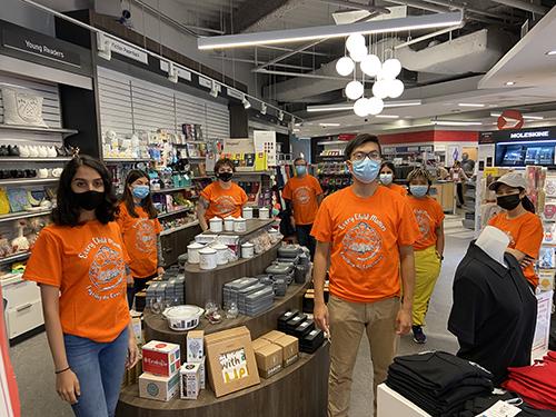 The York University Bookstore staff on campus wearing orange shirts.