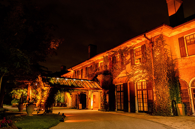 image of Glendon Manor on the Glendon Campus illuminated with orange light as part of the National Day for Truth and Reconciliation