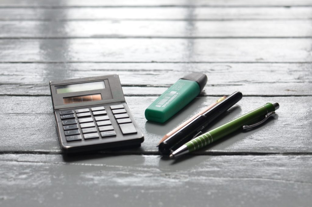 Image of a calculator and pens