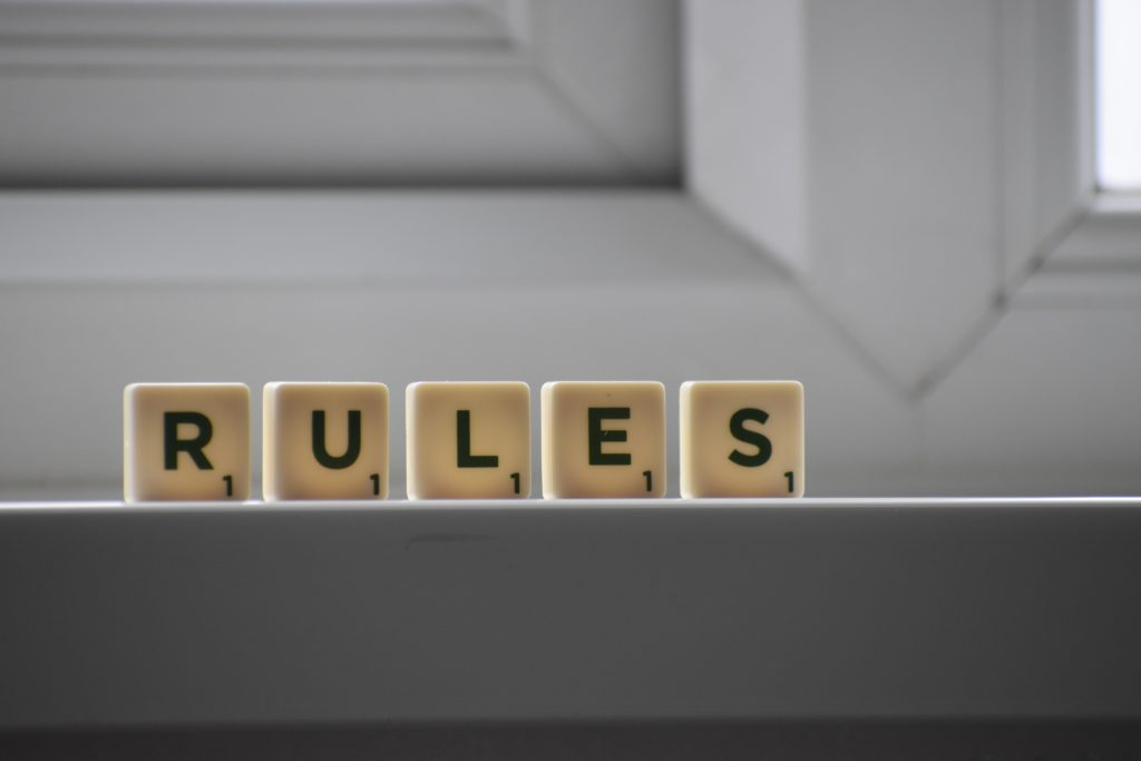 """five little blocks forming the word """"RULES"""""""