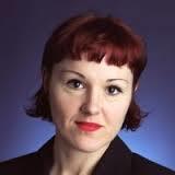 A headshot of Ellen Schraa.
