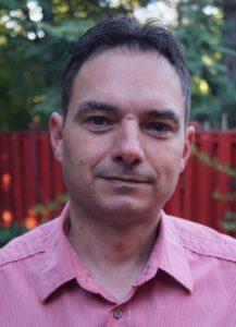 A headshot of Serban Dinca Panaitescu.