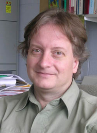 A headshot of Geoffrey Reaume.