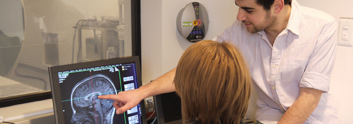 Two researchers analyzing a brain scan in the MRI lab