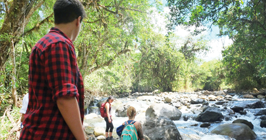 Global Health student Andre standing near a river in Costa Rica