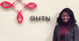 Global Health student Oyewunmi standing in the Ontario HIV Treatment Network office