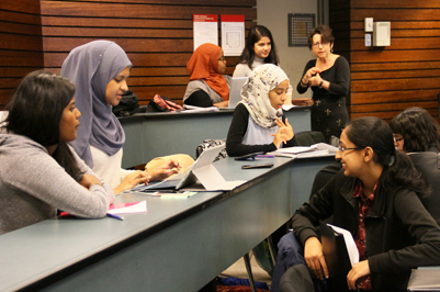 Students talking in a lecture hall.