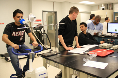 Kinesiology students conducting research in a lab.