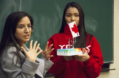 Two students giving a presentation.