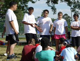 Kinesiology students teaching children at soccer camp