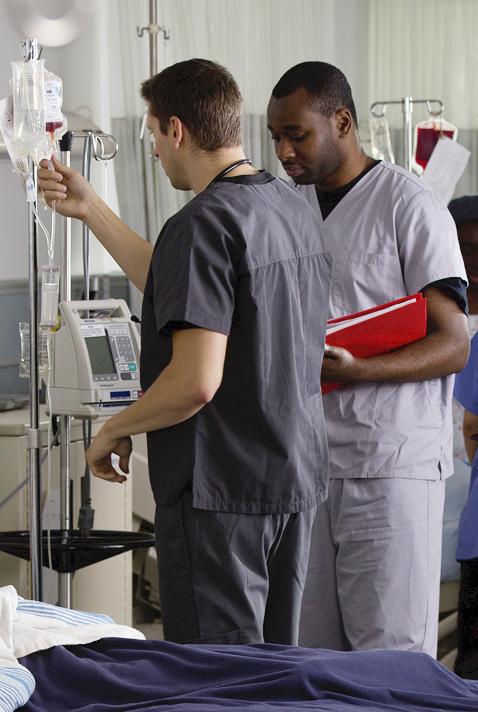 Nurses by a hospital bed