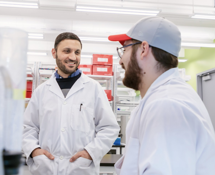 Two students talking in a lab