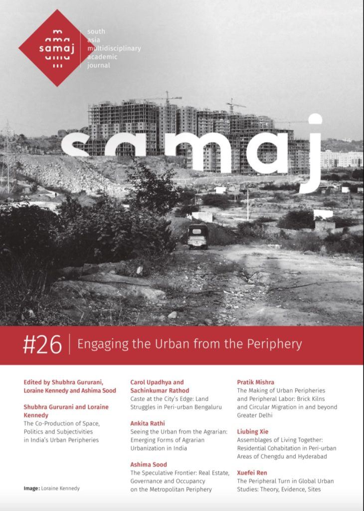 Journal Cover Page. The top half of the page has a black and white image of a constructional area in India with the title Samaj embedded in the photo. The bottom half of the page provides information on the journal articles and authors.
