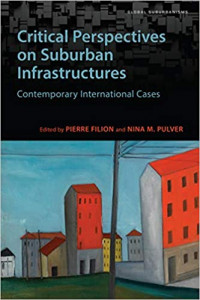 Book cover with the title at the top half in black background and a cartoon image of buildings at the bottom half