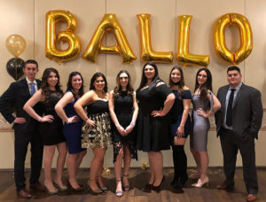 Italian Student Club members pose for group photo at Masquerade Ball event