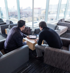 two students studying in Kanef lounge