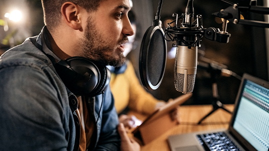 podcaster host speaking into mic