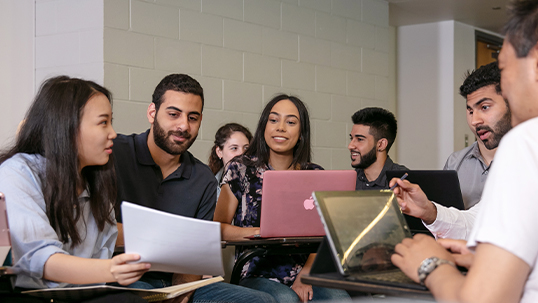 group of engaged students studying together