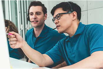 two male students studying together