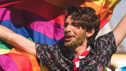 unfurling pride flag