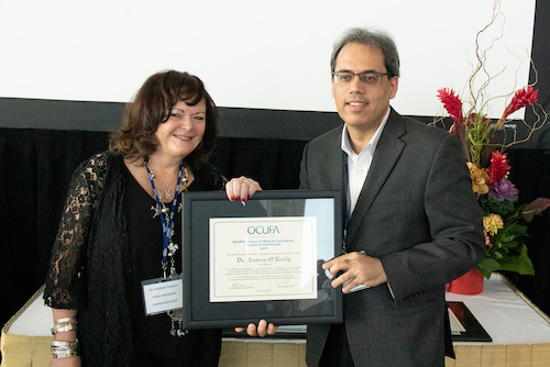 GSWS professor Andrea O'Reilly being presented with award