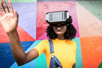 Black woman wearing VR headset
