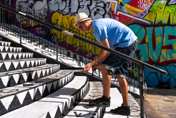 Male student examining public art