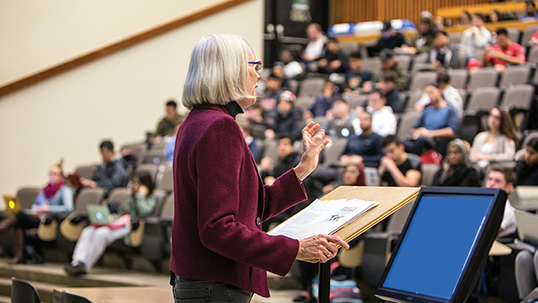 female professor lecturing to students