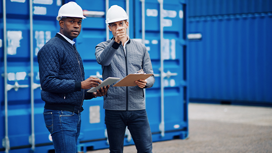 two men in hardhats at storage site