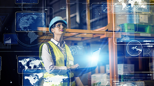 woman in hard hat and high visibility vest in supply warehouse