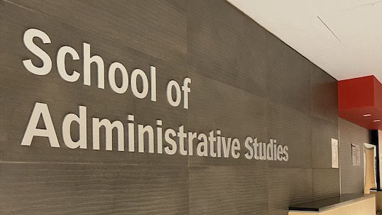 School of Administrative Studies front desk wall sign