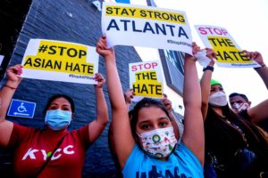 protesters with stop Asian hate crime signs