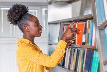 black woman shelving books