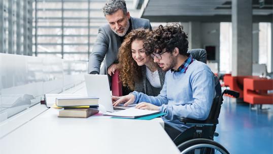 three people using laptop