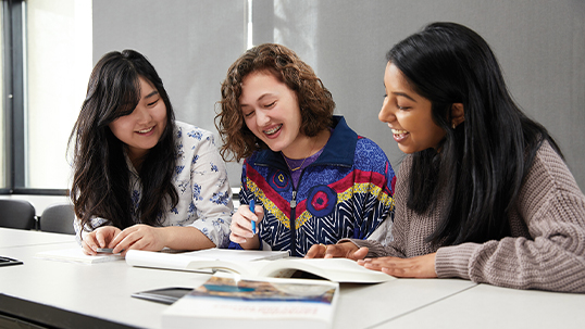 three female students studying book